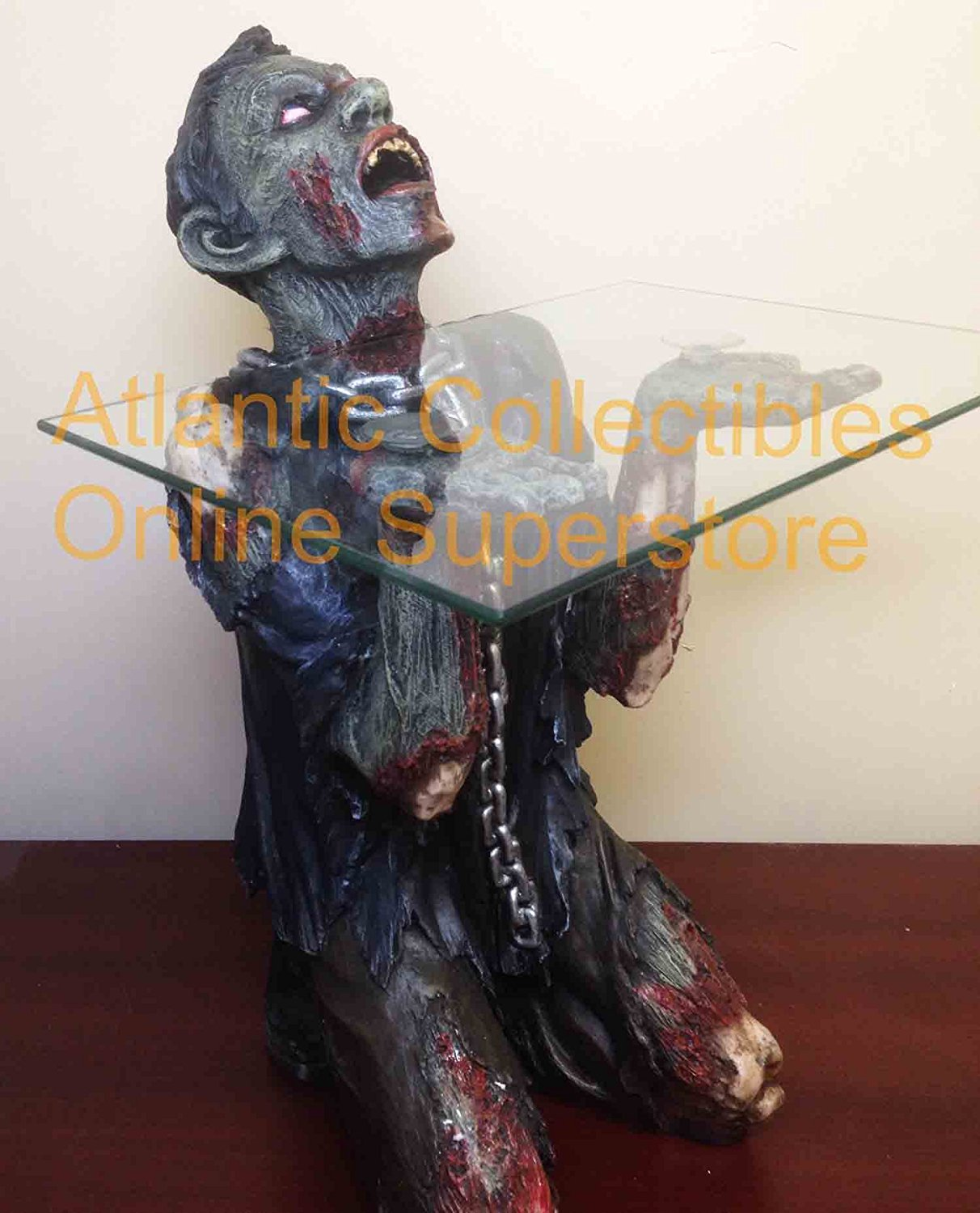 Enslave the dead with this zombie side table dread central for Table zombies