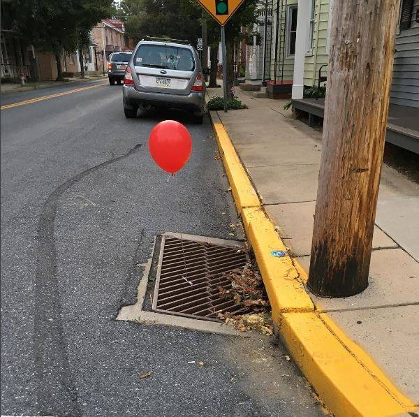 Prankster freaks out cops with 'IT' balloons tied to sewer grates