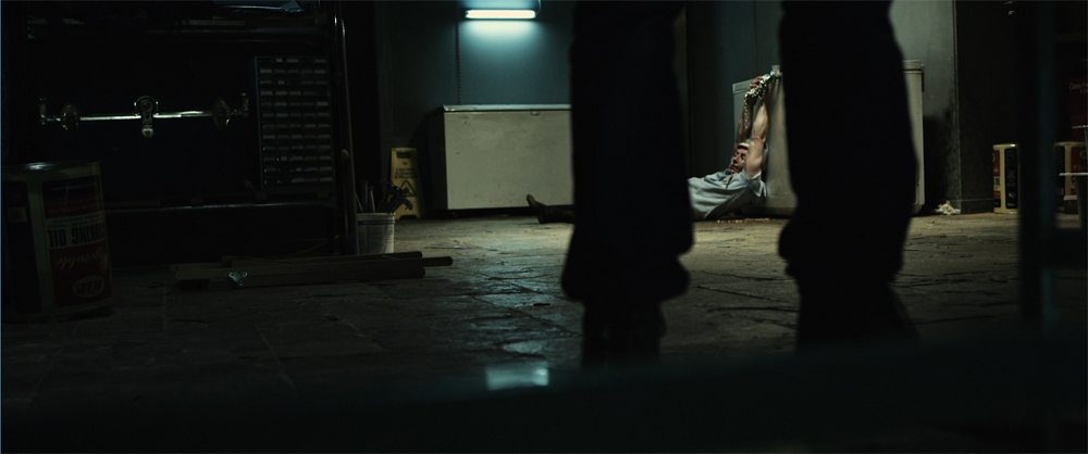 salah arrives in the basement - Exclusive: Breaking Glass Releasing Cannibal Horror Film K-Shop in North America; New Trailer, Stills, and More!