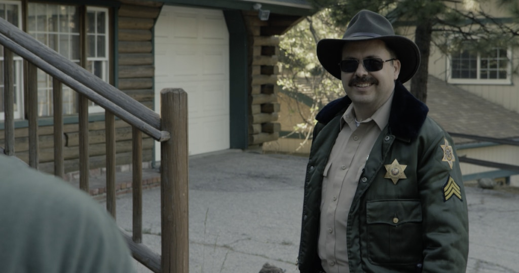 DryBlood Cop 1024x538 - Dread Central Presents: We're Heading Into the Mountains With DRY BLOOD!
