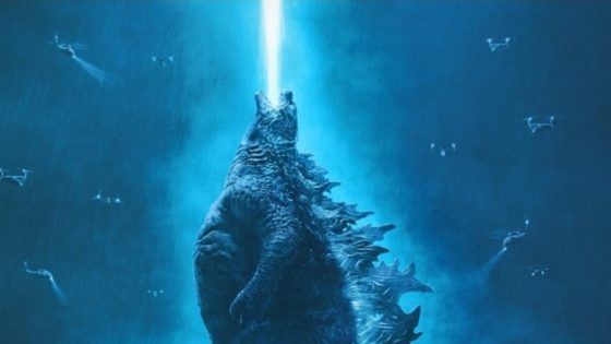 Godzilla King of the Monsters Banner 560x315 - Man and Creature Converge in Latest Awesome Poster for GODZILLA: KING OF THE MONSTERS