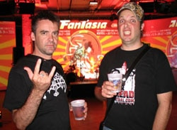 A few beers in at the opening night party. Paul salutes Satan while Andy does his best Chatterer impression.