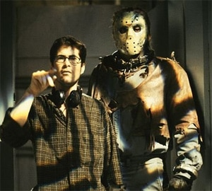Jim Isaace (pictured with Kane Hodder on the set of Jason X) on to the Pig Farm