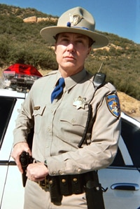 Perkins as a cop in Live Evil
